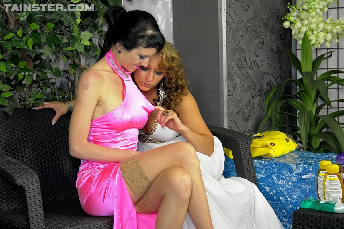 Two Sexy Women With Liquids and Oils